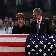 Pres. Bush and first lady Laura Bush pay their respects at the casket of President Reagan in the Rotunda of the US Capitol Thursday, June 10, 2004.  The former president will lie-in-state there until Friday morning...Photo by Khue Bui