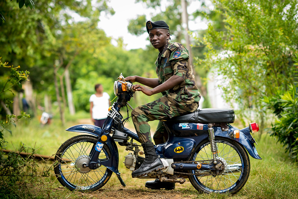 July 22, 2017, El Mamon, Dominican Republic:<br /> A military soldier poses for a portrait on his motorcycle in El Mam&oacute;n during the 2017 Lindos Sue&ntilde;os trip in the Dominican Republic Saturday, July 22, 2017. <br /> (Photo by Billie Weiss/Boston Red Sox)