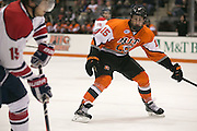 RIT's Max Mikowski on the forecheck during a game against Brock University at the Gene Polisseni Center on Saturday, October 4, 2014.