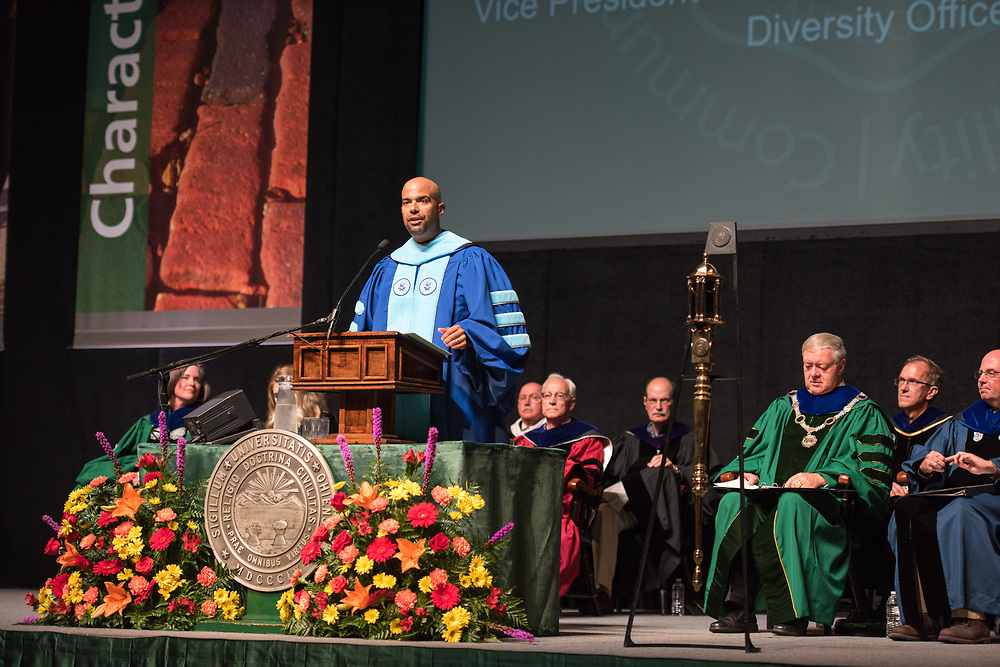 Jason Pina, vice president for student affairs, speaks at the President's Convocation for First-Year Students at the Convocation Center. Photo by Ben Siegel