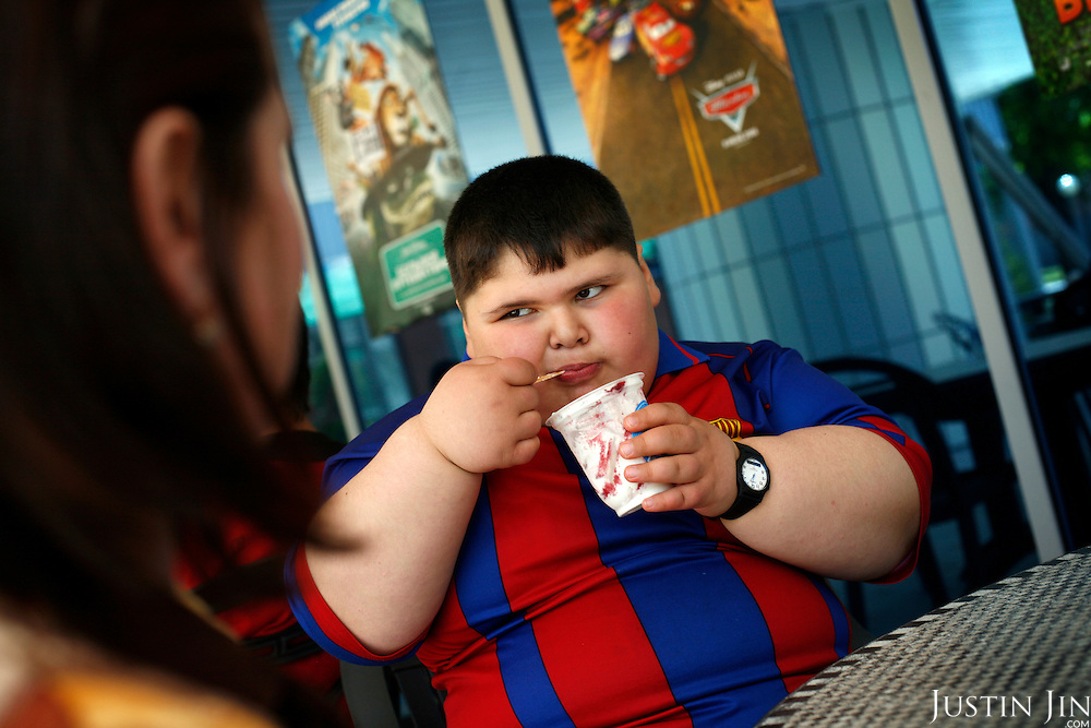 Dzhambulat Khotokhov, 6, one of the fattest boys in the world, drinks from a fountain in his home town Terek, in southern Russia. .Now 1.4 metres tall and weighing about 100 kg, Khotokhov has grabbed world attention as the biggest kid in the world since he was three. .Khotokhov lives with his mother Neyla and his brother, 14-year-old Mukha. .