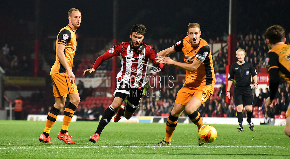 Marco Djuricin looks to beat Michael Dawson and the Hull defence during the Sky Bet Championship match between Brentford and Hull City at Griffin Park, London, England on 3 November 2015. Photo by Michael Hulf.