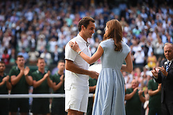 Roger Federer receives the runners up trophy from the Duchess of Cambridge after the Men's Singles Final match against Serbian Novak Djokovic at Wimbledon on Sunday, July 14, 2019. Djokovic won the match 7-6,1-6,7-6,4-6,13-12. Photo by ABACAPRESS.COM