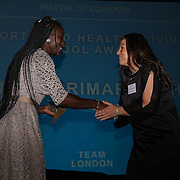 London, UK. 31st Oct, 2016. Lesley Owusu presents award to Sports & healthy living awards to Granton Primary School at Team London award in City Hall, the awards are to recognise Volunteers' efforts to improve life in the capital Awards at City Hall, London,UK. Photo by See Li5
