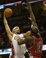 PHOTO BY DAVID RICHARD.Drew Gooden goes up for a slam dunk against the defense of Jumaine Jones of Charlotte.