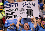 """A male Detroit Lions fan holds up a sign that states """"ESPN Monday Night Football, Back in the Lions D"""" during the NFL week 5 football game against the Chicago Bears on Monday, October 10, 2011 in Detroit, Michigan. The Lions won the game 24-13 to open the season with a 5-0 record. ©Paul Anthony Spinelli"""