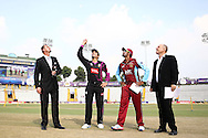 Faisalabad Wolves captain Misbah-Ul-Haq tosses the coin as Kandurata Maroons captain Lahiru Thirimanne calls and Match Referee Andy Pycroft looks on during the Qualifier 5 match of the Karbonn Smart Champions League T20 (CLT20) between Faisalabad Wolves and the Kandurata Maroons held at the Punjab Cricket Association Stadium, Mohali on the 20th September 2013<br /> <br /> Photo by Shaun Roy/CLT20/SPORTZPICS<br /> <br /> <br /> Use of this image is subject to the terms and conditions as outlined by the CLT20. These terms can be found by following this link:<br /> <br /> http://sportzpics.photoshelter.com/image/I0000NmDchxxGVv4<br /> <br /> ENTER YOUR EMAIL ADDRESS TO DOWNLOAD