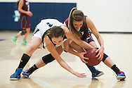 MMU's Ellie Devereux (1) and North Country's Carley Giroux (2) battle for the loose ball during the girls basketball game between the North Country Falcons and the Mount Mansfield Cougars at MMU high school on Monday night February 15, 2016 in Jericho. (BRIAN JENKINS/for the FREE PRESS)