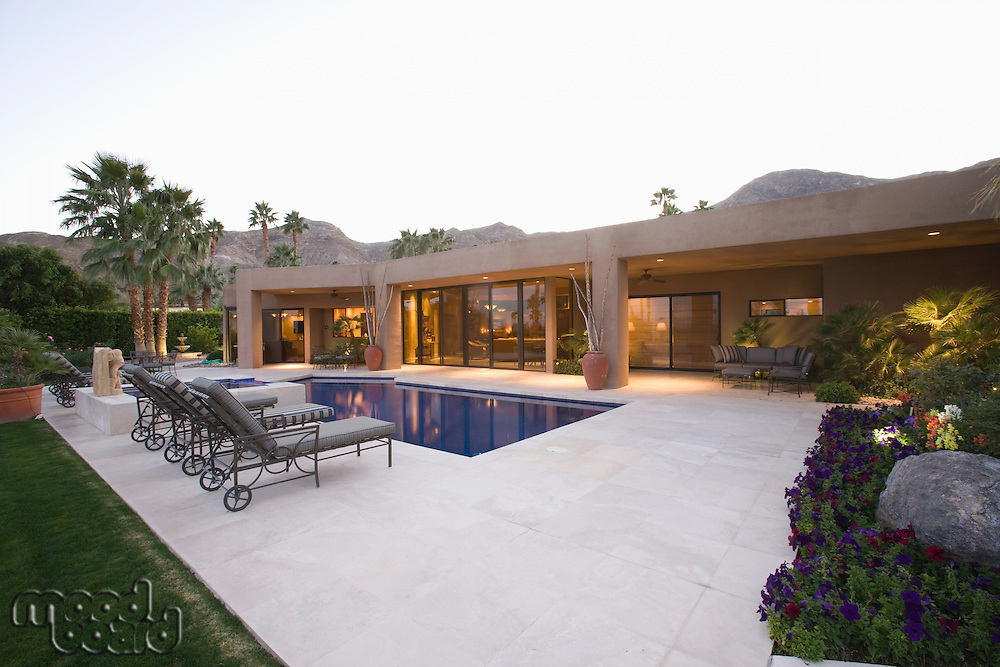 Poolside area with sun loungers Palm Springs home