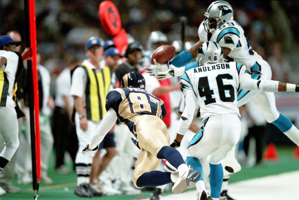 Linebacker Darren Hambrick (59) and Defensive back Rashard Anderson (46 of the Carolina Panthers try to intercept a pass meant for Wide Receiver Ricky Proehl (87) of the St. Louis Rams during a 48 to 14 win by the Rams on 11/11/2001..©Wesley Hitt/NFL Photos