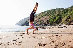 Jul. 25, 2012 - Woman doing handstand on beach (Credit Image: © Image Source/ZUMAPRESS.com)