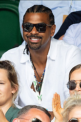 © Licensed to London News Pictures. 09/07/2018. London, UK. Boxer David Haye on the centre court during the Wimbledon Tennis Championships 2018, at the All England Lawn Tennis and Croquet Club. Photo credit: Ray Tang/LNP