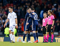Football - 2018 / 2019 UEFA European Championship Qualifier - Group I: Scotland vs. Cyprus<br /> <br /> Kenny McLean of Scotland and Oliver Burke of Scotland at full time in the European Championship Qualifying match between Scotland and Cyprus, at Hampden Park, Glasgow.<br /> <br /> COLORSPORT/BRUCE WHITE