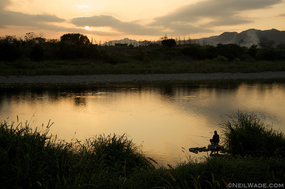 Fishing at sunset in Taipei, Taiwan.
