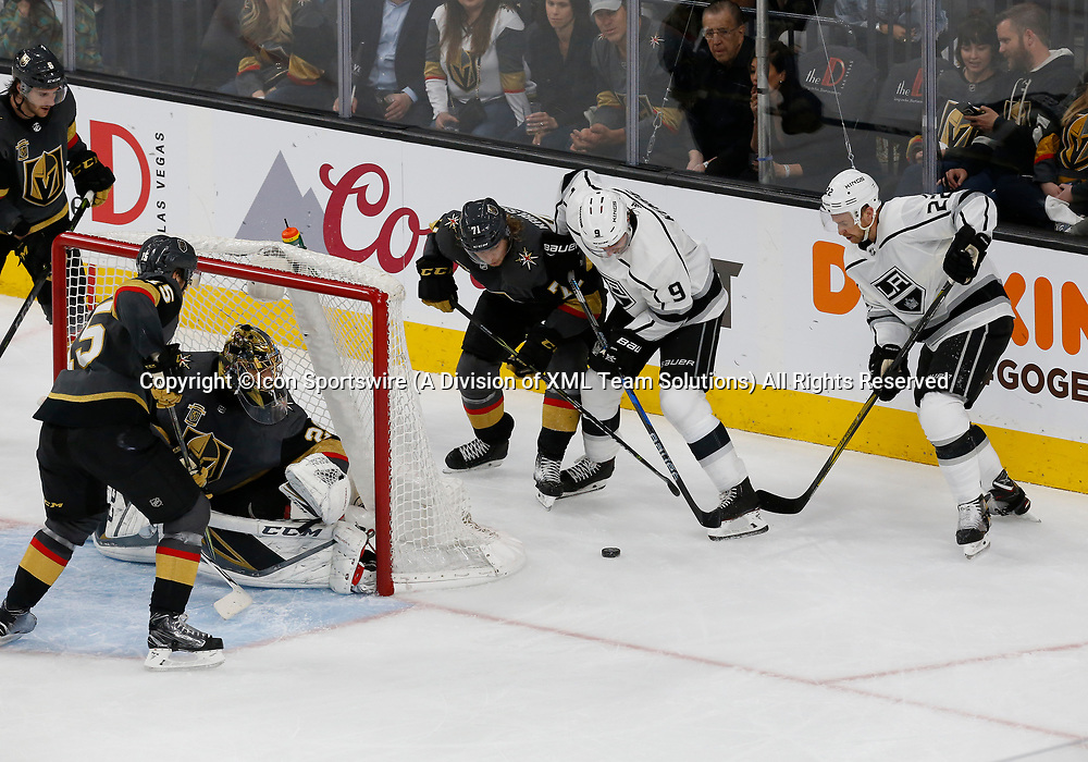 LAS VEGAS, NV - APRIL 11: Vegas Golden Knights center William Karlsson (71) and Los Angeles Kings left wing Adrian Kempe (9) battle for the puck during Game One of the Western Conference First Round of the 2018 NHL Stanley Cup Playoffs between the L.A. Kings and the Vegas Golden Knights Wednesday, April 11, 2018, at T-Mobile Arena in Las Vegas, Nevada. The Golden Knights won 1-0.  (Photo by: Marc Sanchez/Icon Sportswire)
