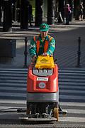A city street cleaning operator drives his small vehicle along Slovenska Cesta (street) in the Slovenian capital, Ljubljana, on 25th June 2018, in Ljubljana, Slovenia.