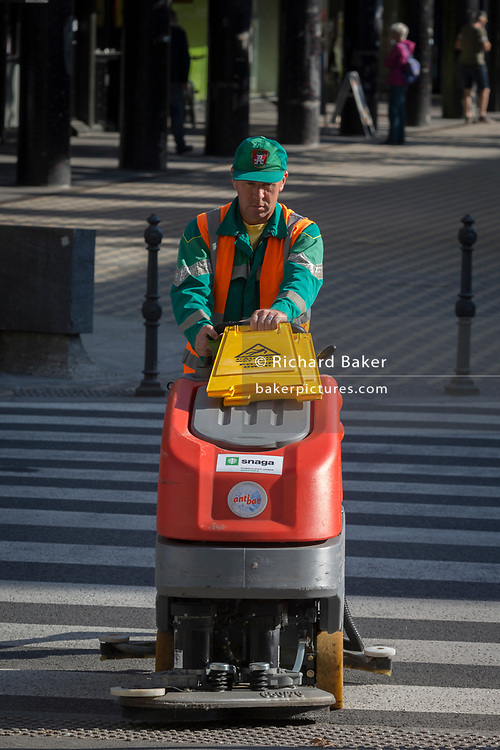 A city street cleaning operator drives his small vehicle along Slovenska Cesta (street) in the Slovenian capital, Ljubljana, on 25th June 2018, in Ljubljana, Slovenia.