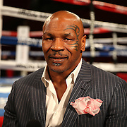 "Boxing promoter Mike Tyson readies himself for a television interview prior to the ""Judgemnt Day"" boxing event at American Airlines Arena on Thursday, July 10, 2014 in Miami, Florida.  (AP Photo/Alex Menendez)"