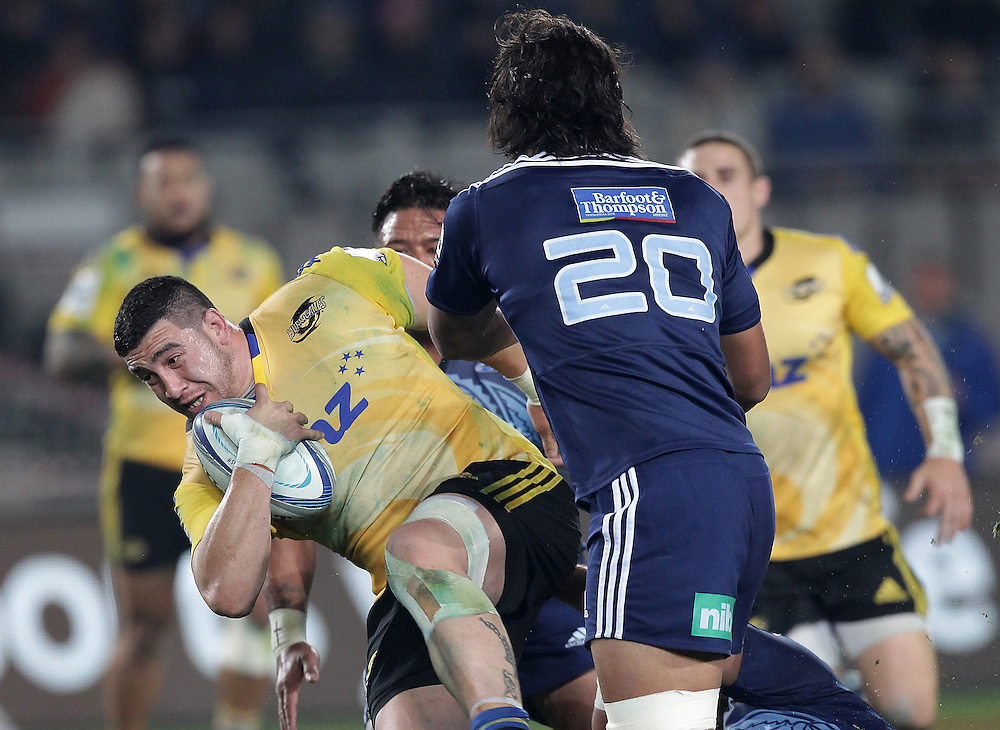 Hurricanes' Jeffery Toomaga-Allen is challenged by Blues' Steven Luatua in a Super Rugby match, Eden Park, Auckland, New Zealand, Saturday, May 31, 2014.  Credit:SNPA / David Rowland