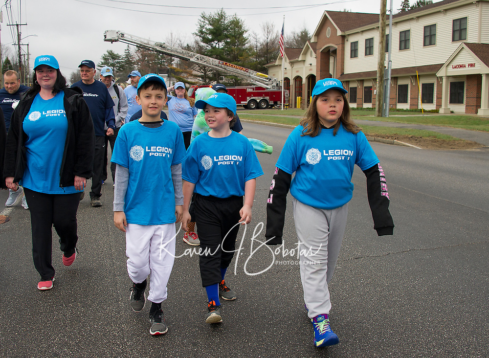The American Legion Post 1Minor's team marches down North Main St. to Opechee Park during the Laconia Little League opening day parade Saturday morning.  (Karen Bobotas/for the Laconia Daily Sun)