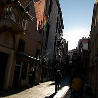 Italy, Veneto, Venice. November/12/2007...Tourists stroll the cobbled streets of Venice under a mid-day sun.