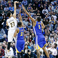 13 February 2017: Denver Nuggets guard Jamal Murray (27) takes a jump shot over Denver Nuggets forward Golden State Warriors guard Ian Clark (21) and Golden State Warriors forward Kevon Looney (5) during the Denver Nuggets 132-110 victory over the Golden State Warriors, at the Pepsi Center, Denver, Colorado, USA.