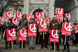 © Licensed to London News Pictures. 26/02/2016. London, UK. Labour supporters holding banners as they  take part in a CND (Campaign for Nuclear Disarmament) rally in central London on February 27, 2016. Expected to attend the event are Labour leader Jeremy Corbyn,  leader of the SNP Nicola Sturgeon and Plaid Cymru's Leanne Wood. Photo credit: Ben Cawthra/LNP