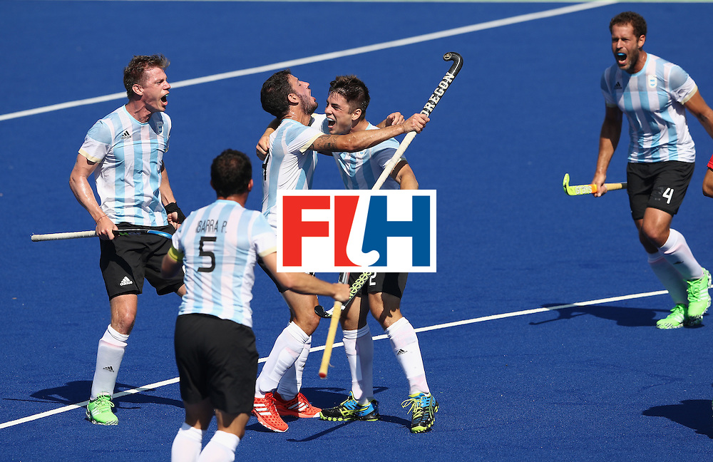 RIO DE JANEIRO, BRAZIL - AUGUST 14:  Gonzalo Peillat of Argentina celebrates with team mates after scoring the first goal during the Men's hockey quarter final match between Spain and Argentina on Day 9 of the Rio 2016 Olympic Games at the Olympic Hockey Centre on August 14, 2016 in Rio de Janeiro, Brazil.  (Photo by David Rogers/Getty Images)
