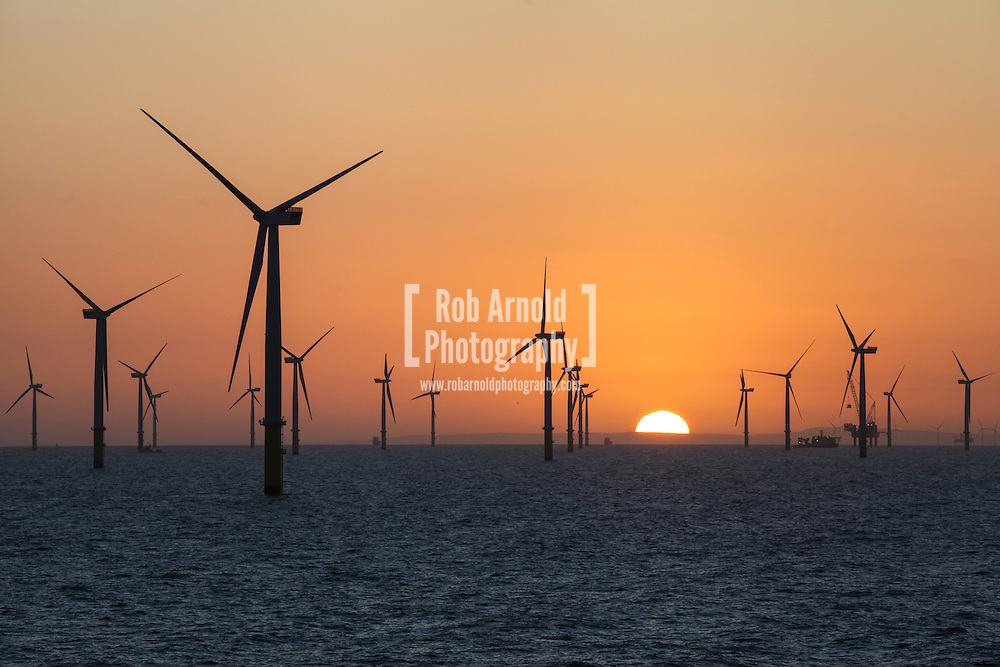 Sunrise over the Gwynt y Mor Offshore Wind Farm off the coast of North Wales, UK