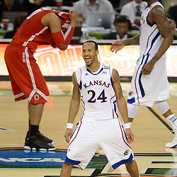 Mar 31, 2012; New Orleans, LA, USA; Kansas Jayhawks guard Travis Releford (24) celebrates after defeating the Ohio State Buckeyes 64-62 in the semifinals of the 2012 NCAA men's basketball Final Four at the Mercedes-Benz Superdome. Mandatory Credit: Derick E. Hingle-US PRESSWIRE