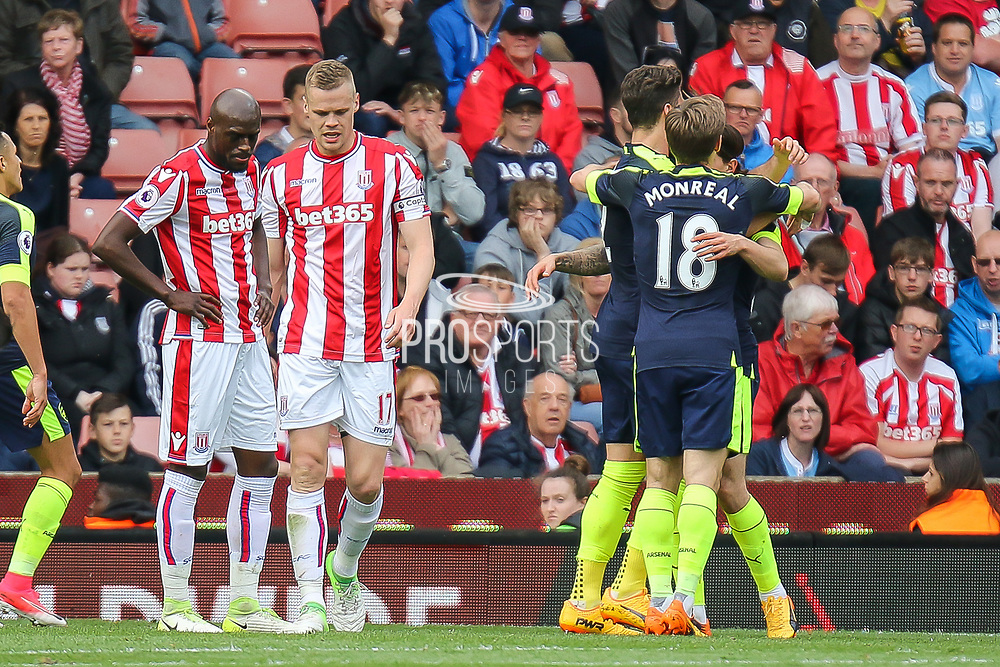 Arsenal defender Nacho Monreal and Arsenal forward Olivier Giroud celebrate Arsenal scoring the opening goal (0-1) during the Premier League match between Stoke City and Arsenal at the Bet365 Stadium, Stoke-on-Trent, England on 13 May 2017. Photo by Aaron  Lupton.