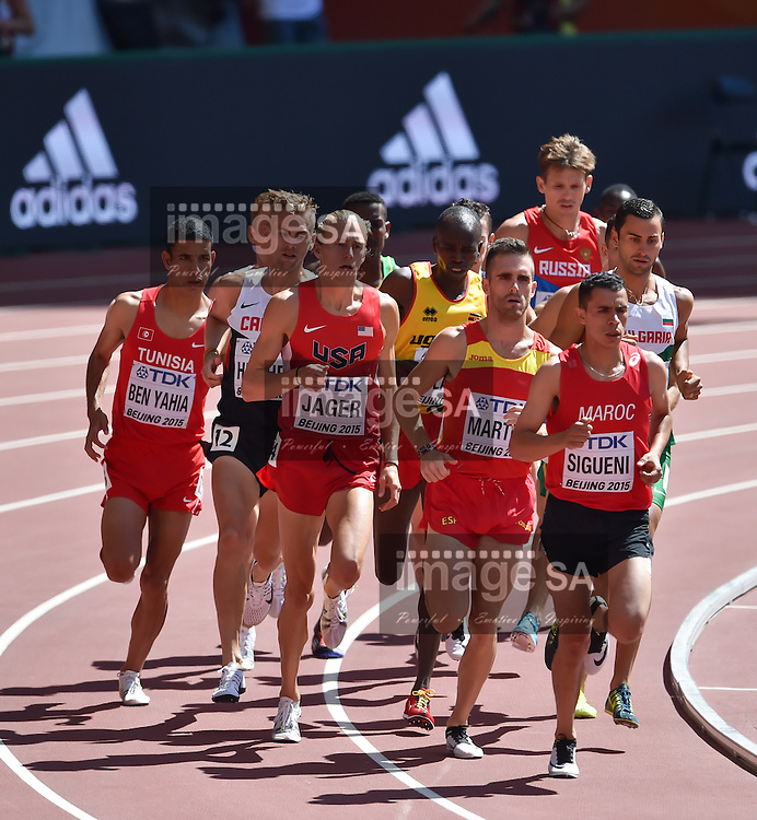 BEIJING, CHINA - AUGUST 22: Amor Ben Yahia (Tunisia), Matthew Hughes (Canada), Evan Jager (USA), Benjamin Kiplagat (Uganda), Sebastian Martos (Spain) and Hicham Sigueni (Morocco) in Round 1 of the mens 3000m steeplechase during day 1 of the 2015 IAAF World Championships at National Stadium on August 22, 2015 in Beijing, China. (Photo by Roger Sedres/Gallo Images)