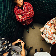Rex Flake, Yuri Choufour, and Jay Goodrich run into one of the Stevens Pass employees in an elevator on their way to go ride.