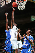 Dec 07, 2011; Birmingham, AL, USA; UAB Blazers forward Cameron Moore (22) shoots over Middle Tennessee Blue Raiders forward Shawn Jones (12) at  Bartow Arena. The Blazers defeated the Blue Raiders 66-56 Mandatory Credit: Marvin Gentry-