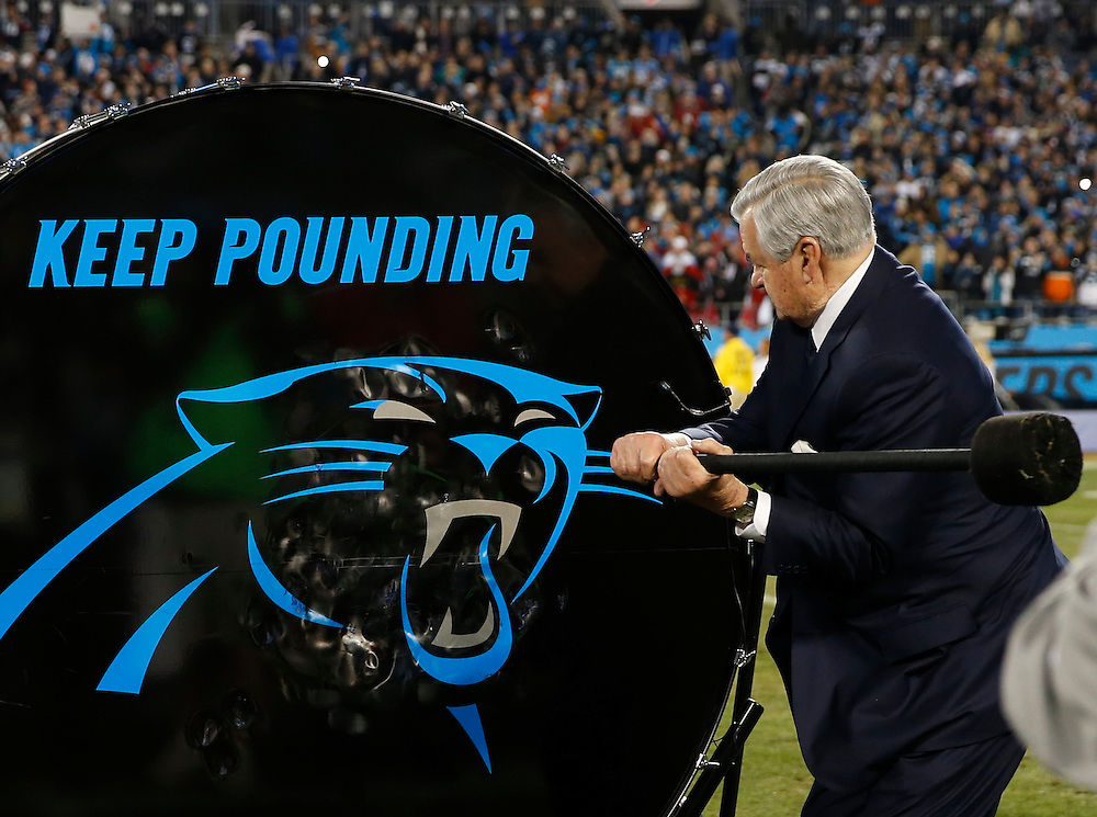 "CHARLOTTE, NC - JAN 24:  Carolina Panthers owner Jerry Richardson hits the""Keep Pounding"" drum before the NFC Championship game against the Arizona Cardinals at Bank of America Stadium on January 24, 2016 in Charlotte, North Carolina."