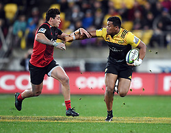 Hurricanes Julian Savea, right, fends off Crusaders David Havili in Super Rugby match at Westpac Stadium, Wellington, New Zealand, Saturday, July 15, 2017. Credit:SNPA / Ross Setford  **NO ARCHIVING""