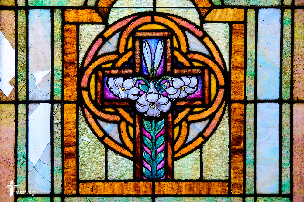 Stained glass depicting the the cross with lily flowers on Wednesday, Sept. 20, 2017, at Prince of Peace Lutheran Church in the Over-the-Rhine neighborhood of Cincinnati. LCMS Communications/Erik M. Lunsford