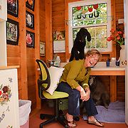 Charlotte Owendyk shares her office with dogs in Roseville, Calif.