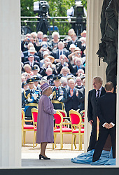 © London News Pictures. 28/06/2012.  London, UK. HRH Queen Elizabeth II unveils a new £3.5m Bomber Command Memorial in Green Park, London dedicated to the 55,573 airmen who died in the Second World War. The pavilion, made of Portland Stone stands at over 8m tall with an open roof. The entrance is made from melted down aluminium sections of a Halifax bomber shot down during the war and in which all seven of the crew were killed. The memorial includes inscriptions from Winston Churchill. Photo credit: Ben Cawthra/LNP