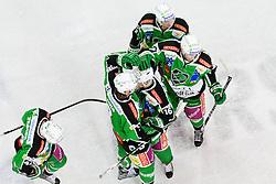 Players of HDD Tilia Olimpija celebrate during ice-hockey match between HDD Tilia Olimpija and EHC Liwest Black Wings Linz at fourth match in Semifinal  of EBEL league, on March 13, 2012 at Hala Tivoli, Ljubljana, Slovenia. (Photo By Matic Klansek Velej / Sportida)