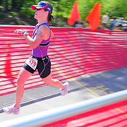 5/31/09 -- BATH, Maine. Jen Rohde of Cumberland closes in on the finish line at the Bath Y Tri on Sunday morning. The Triathalon drew nearly 200 participants and over 100 volunteers to the Bath YMCA. Winners were Kurt Perham for the men and Alicia Trott, both of Brunswick.  Rohde finished second overall in the women's race.  Photo by Roger S. Duncan.