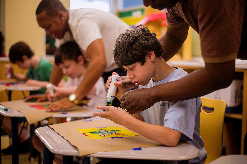NEW YORK, NY - AUGUST 4, 2016: Nicholas Mir, who was born with microcephaly, does a project in his art class at Manhattan Star Academy in New York, New York. CREDIT: Sam Hodgson for The New York Times.