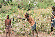 Africa, Tanzania, Lake Eyasi, Hadza men hunting with bow and arrow Small tribe of hunter gatherers AKA Hadzabe Tribe