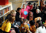 © Licensed to London News Pictures. 06/12/2011, London, UK. (L )BORIS JOHNSON and (R) PETER ANDRE launch  the Love Libraries scheme at Shepherds Bush Library, London, Today 6th December. Love Libraries is a new scheme to encourage Londoners to read and participate in activities at their local libraries. Photo credit : Stephen Simpson/LNP