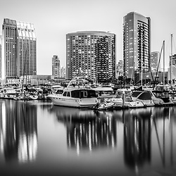 San Diego skyline at night black and white picture with Embarcadero Marina and a reflection of downtown city buildings on the water. For my full portfolio visit http://www.velgos.com