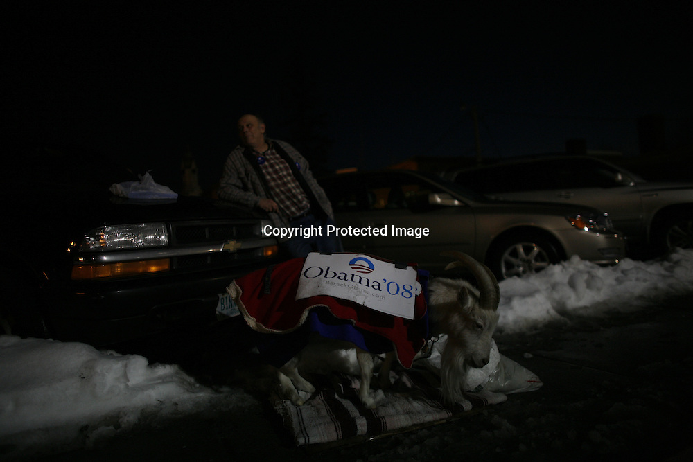 Bill Higgins, a supporter of U.S. Democratic Presidential candidate Senator Barack Obama (D-IL), watches as his goat Binxx wanders around near the site of a campaign stop in Rochester, New Hampshire January 6, 2008.