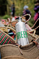 a stainless water bottle with the word Green on it.