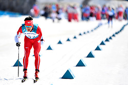 NITTA Yoshihiro JPN LW8 competing in the ParaSkiDeFond, Para Nordic Skiing, Sprint at  the PyeongChang2018 Winter Paralympic Games, South Korea.