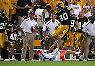 08 SEPTEMBER 2007: Iowa punt returner Andy Brodell (80) jumps over Syracuse punter Rob Long (47) in Iowa's 35-0 win over Syracuse at Kinnick Stadium in Iowa City, Iowa on September 8, 2007.
