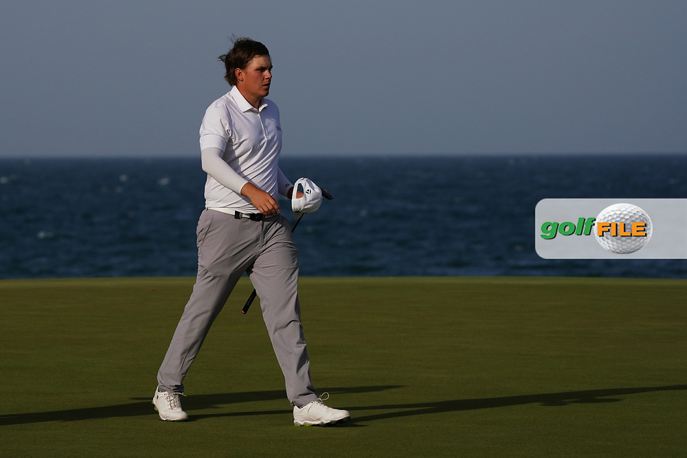 Sami Valimaki (FIN) on the 18th to bring it to a Play Off during Round 4 of the Oman Open 2020 at the Al Mouj Golf Club, Muscat, Oman . 01/03/2020<br /> Picture: Golffile | Thos Caffrey<br /> <br /> <br /> All photo usage must carry mandatory copyright credit (© Golffile | Thos Caffrey)